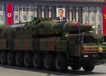 북 신형 장거리 미사일 공개하며 사상최대 열병식